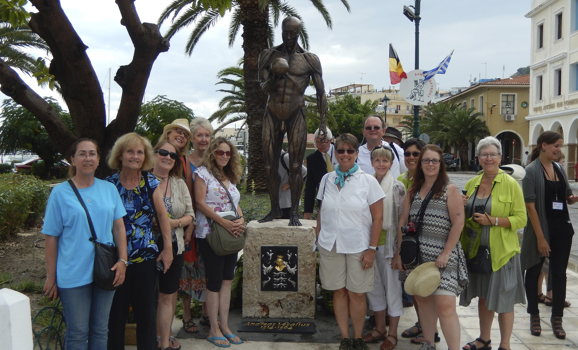 Southern Greece Tour participants pose with the monument to Vesalius in Zakynthos. Vesalius died on this Ionian Island when his ship wrecked there in 1564.